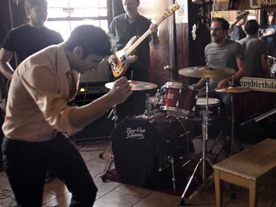 """Low Cut Connie - fronted by Adam Weiner (cq-left, front) stepping away from the paino to strut - perform a practice set in Ray´s """"Happy Birthday"""" Bar November 5, 2012. (Tom Gralish/Staff)"""