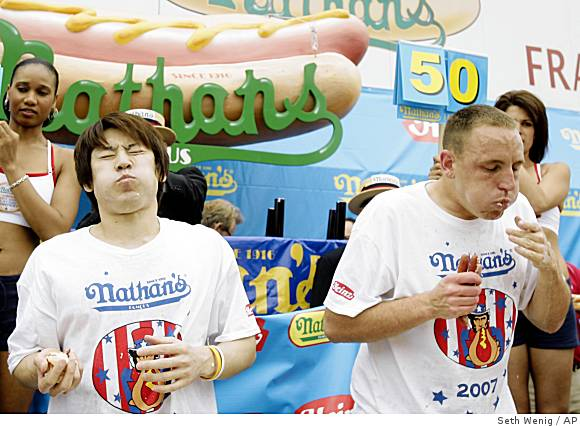 Takeru Kobayashi and Joey Chestnut battle in 2007 Nathan&acute;s contest.<br />(Photo: Seth Wenig/AP)