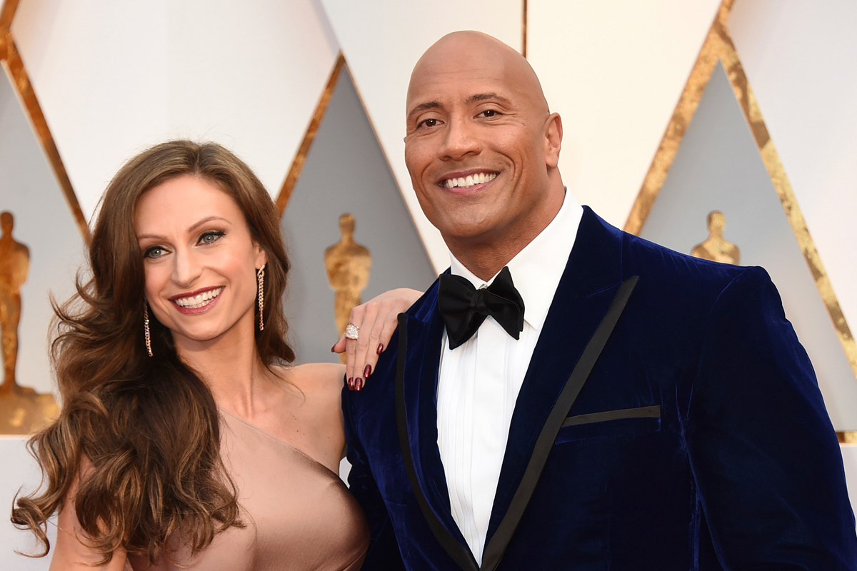 Dwayne Johnson and Lauren Hashian on the red carpet at the Oscars last year.