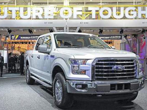 The new 2015 Ford F-150 pick up truck on display during the Detroit auto show on January 13, 2014.