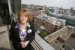"Madeline Bell, chief operating officer at Children's Hospital of Philadelphia, on her office balcony that overlooks Penn's medical campus. In making the $60 million in budget cuts, she said, ""we engaged front-line staff in helping us set targets and look at solutions.""<br />"