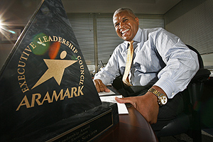 "Aramark executive Dennis Maple at his office at 11th and Market Streets. Maple runs the company's K-12 arm and is charged with improving schools' efficiency and food services. ""It's been seen as a national model,"" he said of Aramark's conservation efforts.<br />"
