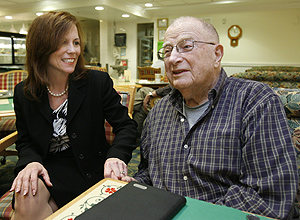 Claire Halton, of ACTS Retirement-Life Communities Inc., one of the managers who gave up a wage increase to save jobs, with resident Daniel A. Rothman.<br />