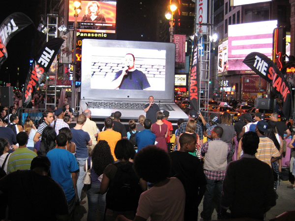 Comedian Brad Trackman performing in Times Square in New York City.