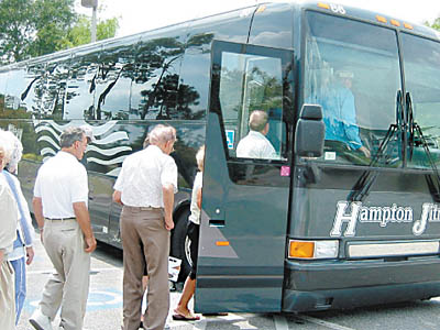 Florida-bound passengers reboard the Hampton Jitney after a stop for lunch in Kingsland, Ga.