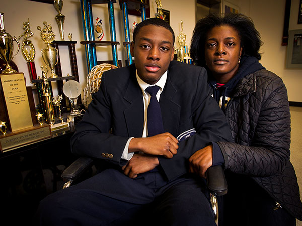 Darrin Manning, a student at Math Civics Science Charter school, was allegedly hurt during an arrest by Philadelphia police. Photograph with his mother Ikea Coney at the school on Monday, January 13, 2014. ( ALEJANDRO A. ALVAREZ / STAFF PHOTOGRAPHER )
