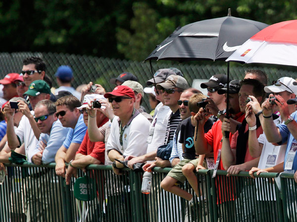 Spectators watch as Tiger Woods practices for the U.S. Open golf tournament at Merion Golf Club, Tuesday, June 11, 2013, in Ardmore, Pa. (AP Photo/Gene J. Puskar)