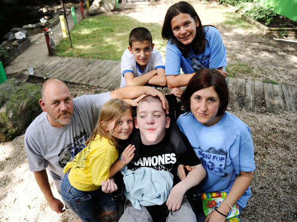 Mick Smith, 12, bottom center right, has a progressive neuromuscular disease. Here, he is pictured with his family: from top left, John Smith, 12, and Grace Smith, 12, and from bottom left, Michael Smith Jr., Martie Smith, 7, and Cathy Smith. Mick, John and Grace are triplets. (Rachel Woolf/Baltimore Sun/MCT)
