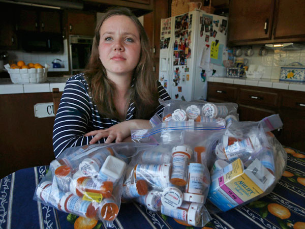 Tessa Gallo poses next to the countless psychotropic drugs she was prescribed during her misdiagnosis for bipolar disorder, at her home in San Jose, Calif., Thursday, April 17, 2014. The 16-year-old has begun to improve vastly since two Stanford doctors identified her condition as PANS, a condition that looks similar to bipolar, but is caused when the body´s immune system attacks the brain. (Karl Mondon/Bay Area News Group/MCT)