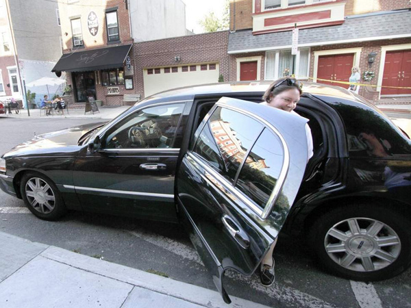 "Stephanie Hilton of East Passyunk steps out of an Uber car in Queen Village after her first ride. ""It was a pretty good 15-minute ride,"" she said. ( ELIZABETH ROBERTSON / Staff Photographer )"