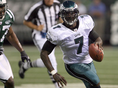 Michael Vick is eligible to see his first game action with the Eagles Sunday against the Chiefs. (Yong Kim / Staff Photographer)
