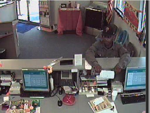 Police say this man ran from the Vist Bank with nearly $12,500 in cash from two drawers and the vault.