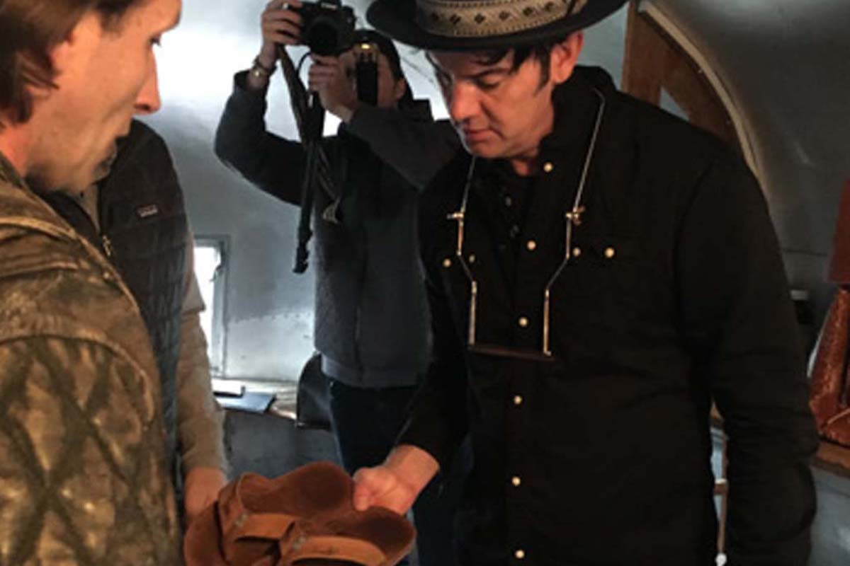 Mike Balitsaris (left), owner of Waltzing Matilda, and Garrett Dutton, of the band G. Love & Special Sauce, talk about a sandal for G. Love´s tour. MIKE BALITSARIS