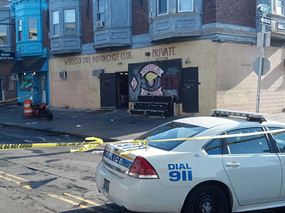 Three men were shot, one fatally, outside the headquarters of Wheels of Soul motorcycle club, in West Philadelphia. (Solomon Leach/Staff)