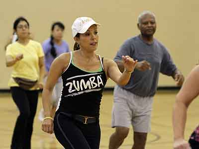 Exercise is one of the ways that women can lower their risk factors for heart problems. (Walter Michot / Miami Herald / MCT)