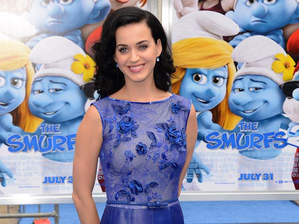 "Singer Katy Perry arrives at the world premiere of ""The Smurfs 2"" at the Regency Village Theatre on Sunday, July 28, 2013 in Los Angeles. (Photo by Jordan Strauss/Invision/AP)"