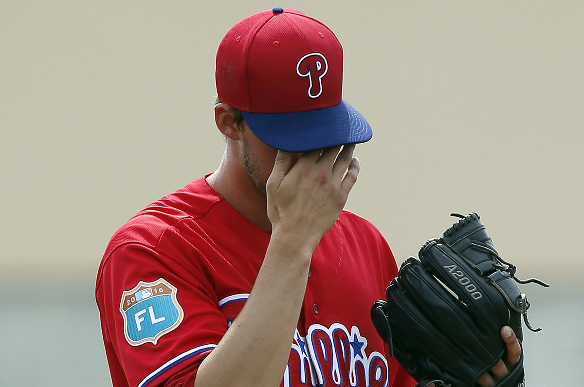 Phillies&acute; pitcher Aaron Nola wipes his face after giving-up at three-run first-inning home run to Toronto Blue Jays&acute; Michael Saunders during a spring training game on Saturday, March 5, 2016 in Dunedin, Florida.  YONG KIM / Staff Photographer <br />