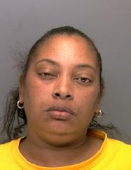 Yolonda Millhouse, 43, of Fern Rock, was caught on surveillance cameras using credit cards that she allegedly stole from a man´s car in Chestnut Hill. (Philadelphia Police photo)