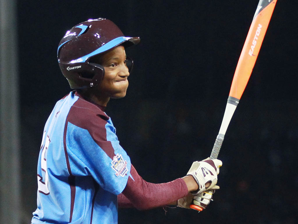 Taney´s #15, Kai Cummings expression says it all after he struck out in the second inning. Undefeated Taney Little League plays undefeated Las Vegas Wednesday night August 20, 2014.   ( MICHAEL BRYANT  / Staff Photographer )