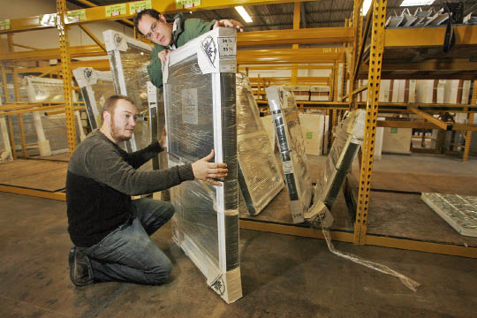 Window consultant Dan Spaeth (left) eyes the inventory with Joe DiMedio Jr. of Pennsauken´s Buy Rite Lumber. (Alejandro A. Alvarez / Staff Photographer)