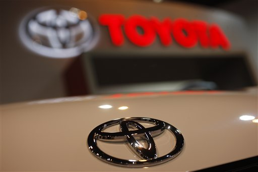 FILE - In this April 17, 2010 file photo, a Toyota emblem is seen on a car trunk lid during the Denver Auto Show in Denver.  Toyota Motor Corp. Tuesday Dec. 21, 2010, agreed to pay the U.S. government a record $32.4 million in additional fines to settle an investigation into its handling of two recalls at the heart of its safety crisis.   (AP Photo/David Zalubowski, file)<br />