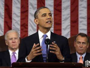 President Barack Obama, flanked by Vice President Joe Biden and House Speaker John Boehner of Ohio, gestures as State of the Union address during a jointhe gives his session of Congress on Capitol Hill in Washington, Tuesday Feb. 12, 2013. (AP Photo/Charles Dharapak, Pool)