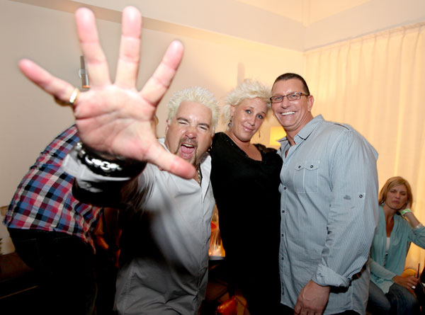 Celebrity chefs Guy Fieri (left), Anne Burrell and Robert Irvine ham it up next to one bemused onlooker at Thursday´s launch party. (Photo: TOM BRIGLIA)