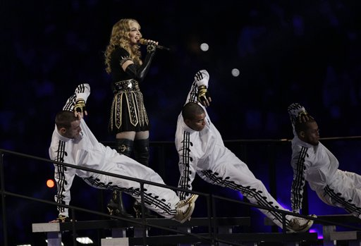 Madonna performs during halftime of the NFL Super Bowl XLVI football game between the New England Patriots and the New York Giants, Sunday, Feb. 5, 2012, in Indianapolis. (AP Photo/Michael Conroy)