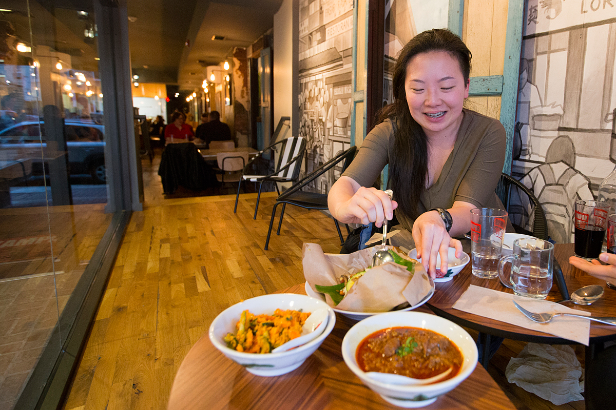 Gloria Lin opens up the Nasilemak Bungkus after food was served to her table at Sate Kampar.