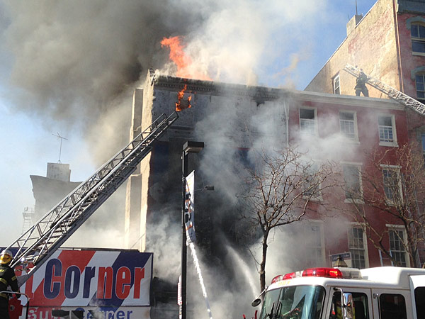 A fire broke out Wednesday morning in the building complex known as the Shirt Corner in downtown Philadelphia. (Emily Babay/Staff)