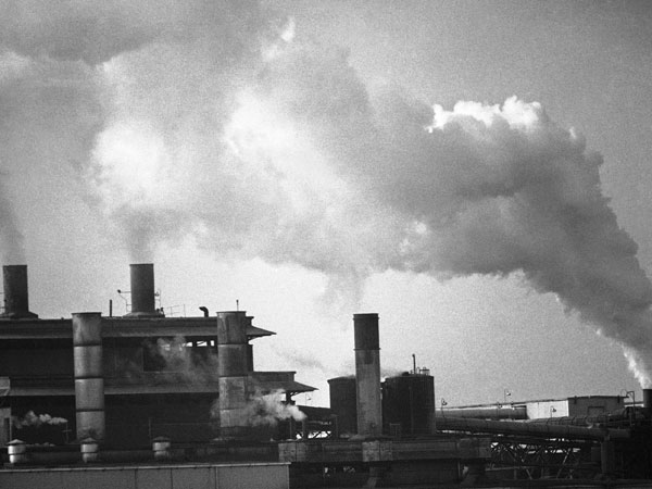 louds of smoke pouring from the stacks of the St. Regis Paper Co. pollute the air over Jacksonville, Fla., April 2, 1970. The paper company heads a list of 150 polluters of the St. Johns River which winds through the center of Jacksonville. (AP Photo)