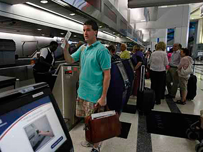 Travelers check in at the Philadelphia International Airport in this August 2010 photo. (Ron Cortes/Staff)
