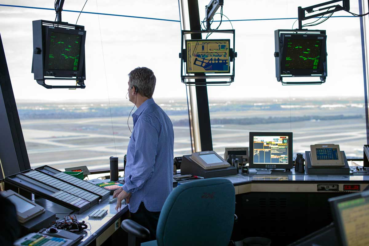 An air traffic controller works in the Dulles International Airport control tower in Sterling, Va. PresidentTrump is calling for privatizing the nation´s air traffic control operations in his budget proposal, a top priority of the airline industry.