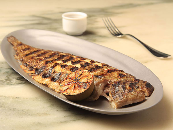 The grilled whole Dover sole at a.kitchen, served bone-in over brown butter-lime vinaigrette, may present a challenge for some diners, but it´s worth it.
