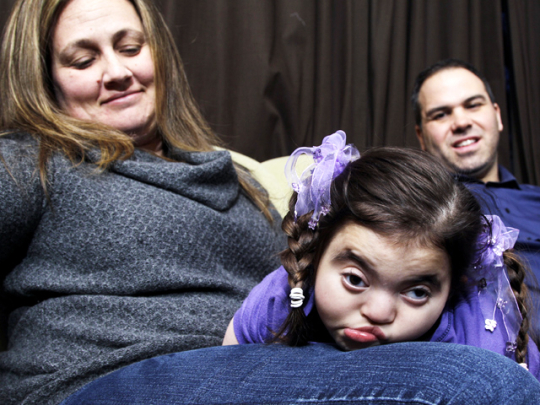 Chrissy and Joe Rivera with daughter Mia.