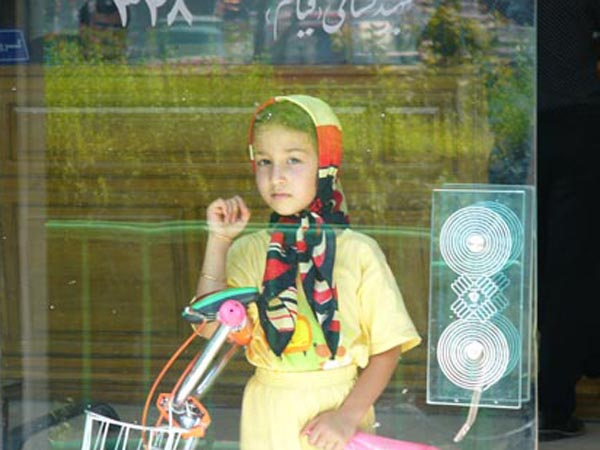 Through the window of a shoe store, this young girl and I watched each other. Eventually, I was able to get her to smile. Yet, it is this photo that stays with me. Where is she now? How will her future unfold?
