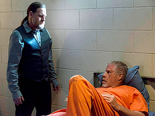 Donal Logue looms over Ron Pearlman in his cell
