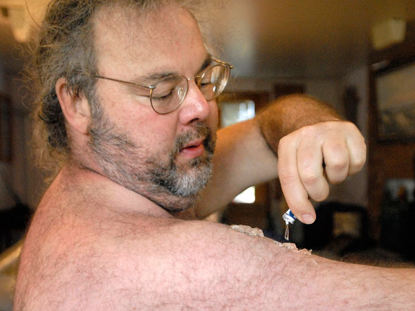 In this photograph taken on Friday, Sept. 11, 2009, Basil Irwin applies AndroGel testosterone gel at his home in Hygiene, Colo. Irwin says that with testosterone replacement therapy he feels much more energetic, has better libido and in general has an improved sense of well being. (AP Photo/The Longmont Times-Call, Richard M. Hackett)