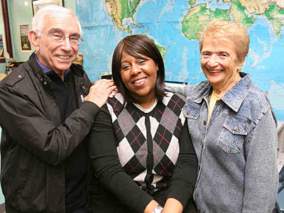 """Out of work since April 2009, Angela Terry (center) was recently hired at Travel Leaders as a corporate travel agent. """"She´s a wonderful person,"""" said Lionel Lauer, with his co-owner Dorothy Polikoff. (Charles Fox/Staff)"""