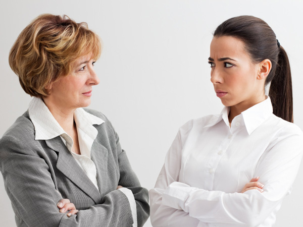 A reader asks if they should their new boss about complaints against her,