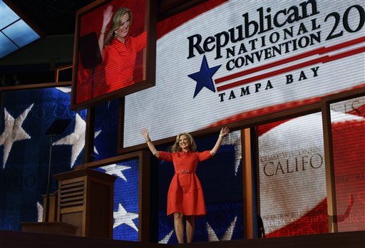 Ann Romney, wife of U.S. Republican presidential nominee Mitt Romney, waves as she walks up to the podium to address the Republican National Convention in Tampa, Fla., on Tuesday, Aug. 28, 2012. (AP Photo/Charles Dharapak)