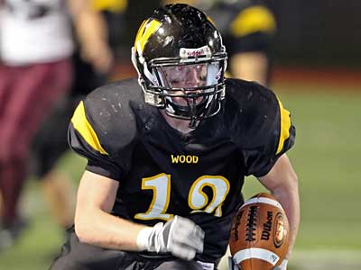 Archbishop Wood´s Sam McCain breaks a 20-yard run during the 2nd quarter in their last game against Pottsgrove. ( Steven M. Falk / Staff Photographer )