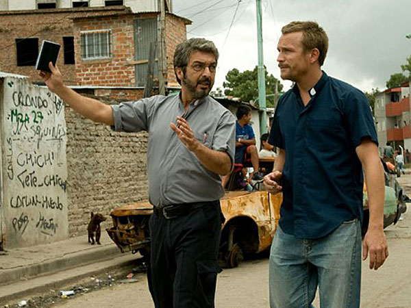 "Ricardo Darin (left) and Jérémie Renier walk the barrios of Buenos Aires in ""White Elephant."""
