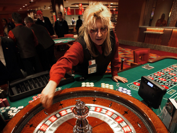 Laureen Jolley spins the roulette wheel in the new Parx East Casino in the old Philly Park building on opening day, December 22. 2010.  (Laurence Kesterson / Staff Photographer)  EDITORS NOTE:  PARX23, 12/22/10, Bensalem, Pa.  The second half of Parx Casino - Parx East - officially opens today (WED -12/22) at 10am with new live table games such as pai-gow, pai-gow tiles, mini-baccarat, geared toward the Asian clientele, as well as 3 card poker, 4 card poker, blackjack, roulette and craps tables. A new dining outlet - The Noodle Bar - also debuts today. This latest expansion adds to last month´s launch of a new poker room on the third floor and has created approximately 400 new jobs at the state´s top grossing casino.