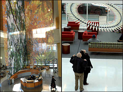 Fabric mobiles with nature motifs decorate the atrium of the Pavilion at Paoli Hospital. At right, Richard Kraus and Christine Kephart of Toms River, N.J., gaze at a Donald Lipski sculpture in the Perelman Center for Advanced Medicine in University City. (April Saul / Tom Gralish / Staff)