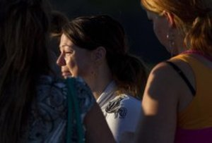 A woman cries outside the school where witnesses were brought for questioning after the July 20 shootings at the multiplex in Aurora, Colo. (AP Photo/Barry Gutierrez)