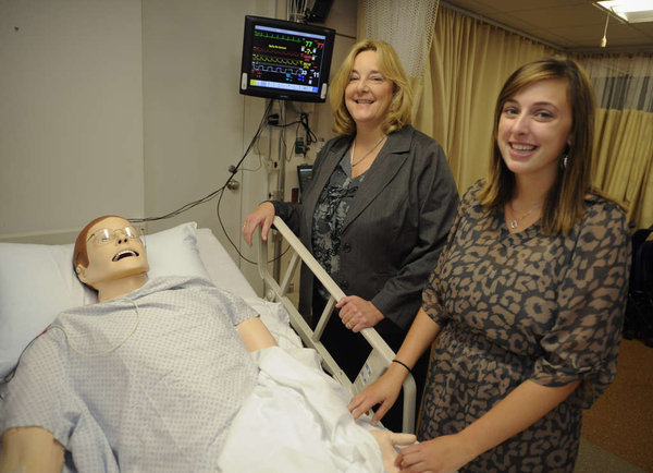 Nurse Susan Cooke and daughter Tara of Mullica Hill in the simulation lab at Drexel&acute;s nursing. Susan Cooke, a nurse for 29 years, is working toward her master&acute;s in nursing leadership at Drexel University Online while continuing her job as an intensive-care unit nursing manager with Kennedy Health System in Stratford. Tara, a sophomore and graduate of Clearview Regional High School, is taking classes at the university to earn her bachelor&acute;s degree in nursing.<br />