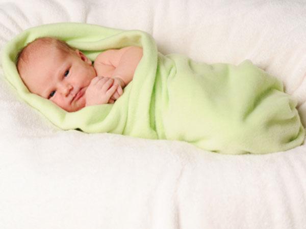newborn baby in swaddle