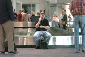 US Airways passengers wait for luggage at Philadelphia International Airport. Worker apathy and a shortage of equipment are among the system´s hurdles.