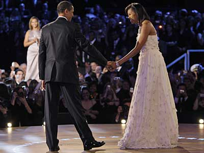 "President Barack Obama and first lady Michelle Obama begin their first dance together at the Neighborhood Inaugural Ball, as Beyonce serenades them with ""At Last."" (Elise Amendola / AP)"
